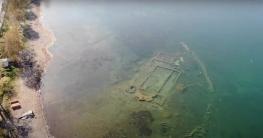 লকডাউনে স্বচ্ছ হ্রদের নিচে উঁকি দিচ্ছে ১৬০০ বছরের প্রাচীন ইতিহাস