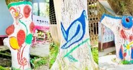 কালীগঞ্জ উপজেলা পরিষদ চত্বরে গাছের গায়ে রং-তুলির আঁচড়